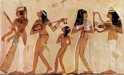 Ancient Egyptian musical instruments including a harp, a lyre and other stringed instruments