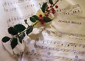 Christmas holly and sheet music for Carols