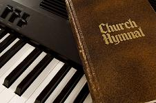 Church Hymnal resting on a keyboard