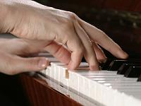 Playing the Piano - close-up