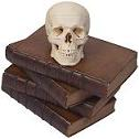 Human Skull on leather-bound books