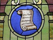 stained glass window with scroll of sheet music notation