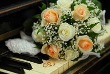 wedding bouquet resting on a piano